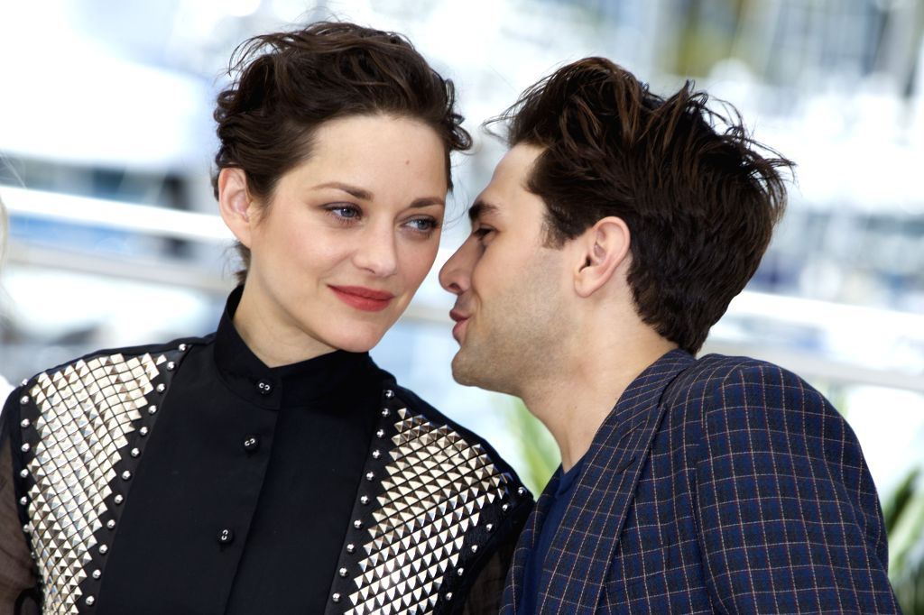 """CANNES, May 19, 2016 - Director Xavier Dolan (R) and actress Marion Cotillard pose during a photocall for the film """"Juste la fin du monde"""" (It's Only the End of the World) in competition at ... - Marion Cotillard"""