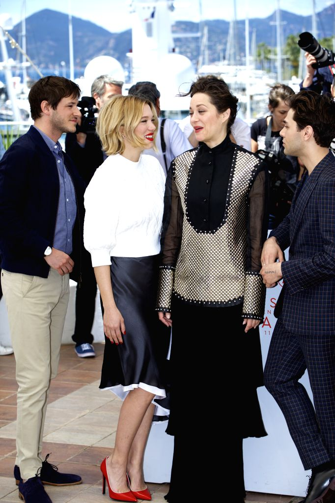 """CANNES, May 19, 2016 - (From L to R) Cast members Gaspard Ulliel, Lea Seydoux, Marion Cotillard and Director Xavier Dolan pose during a photocall for the film """"Juste la fin du monde"""" (It's ..."""