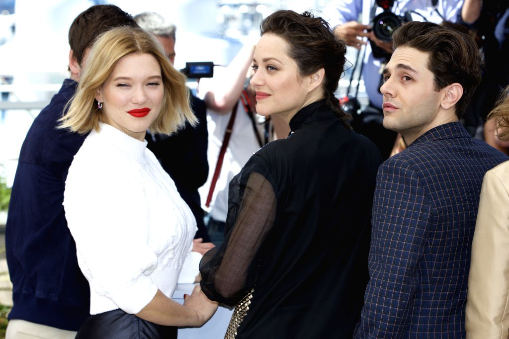 """CANNES, May 19, 2016 - (From L to R) Cast members Lea Seydoux, Marion Cotillard and Director Xavier Dolan pose during a photocall for the film """"Juste la fin du monde"""" (It's Only the End of ..."""