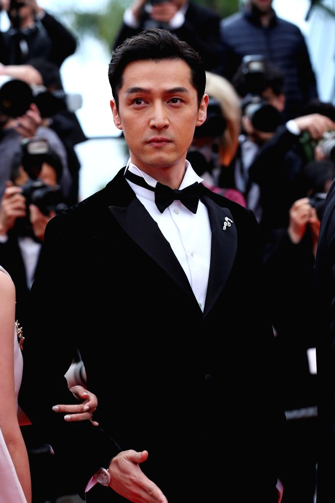 "CANNES, May 19, 2019 - Actor Hu Ge poses on the red carpet for the premiere of the Chinese film ""Wild Goose Lake"" at the 72nd Cannes Film Festival in Cannes, France, on May 18, 2019. The ... - H"