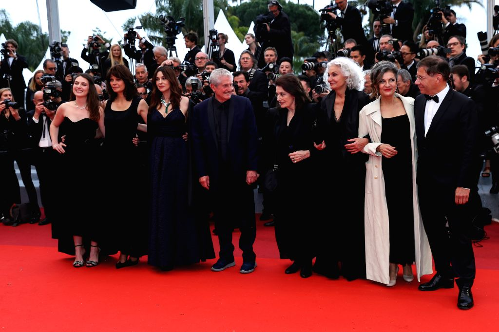 "CANNES, May 19, 2019 - Director Claude Lelouch (4th L) and cast members pose on the red carpet for the premiere of the film ""The Best Years of a Life (Les Plus Belles Annees D'Une Vie)"" at ..."