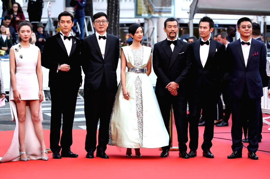 "CANNES, May 19, 2019 - Director Diao Yinan (3rd L) and cast members pose on the red carpet for the premiere of the Chinese film ""Wild Goose Lake"" at the 72nd Cannes Film Festival in Cannes, ..."