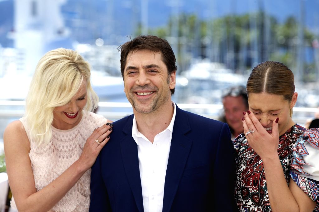 """CANNES, May 20, 2016 - Cast members Charlize Theron (L), Adele Exarchopoulos (R) and Javier Bardem pose during a photocall for the film """"The Last Face"""" in competition at the 69th Cannes ..."""