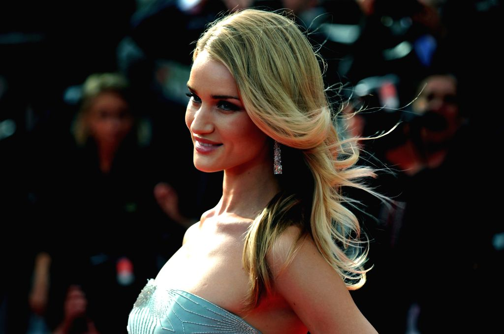 """CANNES, May 21, 2014 (Xinhua) -- Rosie Huntington-Whiteley arrives at the red carpet for the screening of the film """"The Search"""" at the 67th Cannes Film Festival in Cannes, southern France, on May 21, 2014. (Photo: Xinhua/Chen Xiaowei/IANS)"""