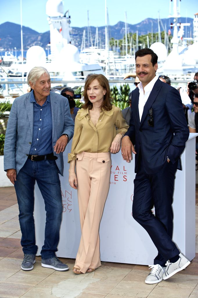 "CANNES, May 21, 2016 - French actress Isabelle Huppert(C), French actor Laurent Lafitte (R) and Dutch director Paul Verhoeven pose on May 21, 2016  during a photocall for the film ""Elle"" at ... - Isabelle Huppert"