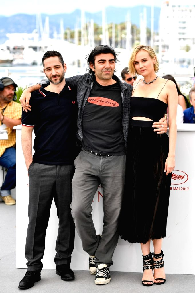 "CANNES, May 26, 2017 - Director Fatih Akin (C) and cast members, Denis Moschitto (L), Diane Kruger (R), of the film ""In the Fade"" pose for a photocall in Cannes, France on May 26, 2017. The ..."