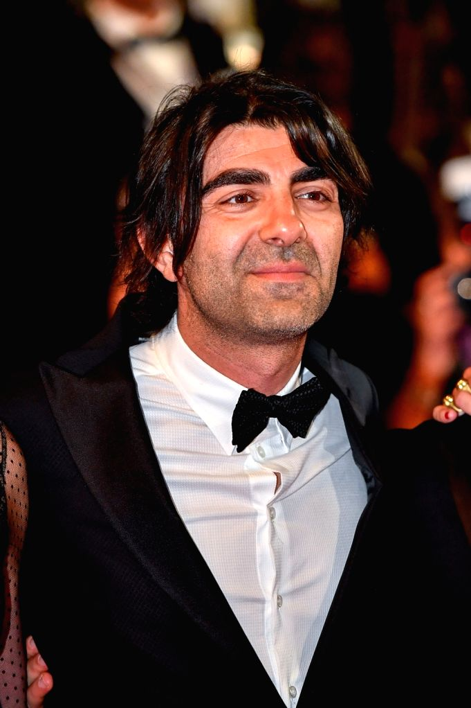 "CANNES, May 26, 2017 - German director Fatih Akin poses for photos on the red carpet for the screening of the film ""In the Fade"" in competition at the 70th Cannes Film Festival in Cannes, ... - Fatih Akin"