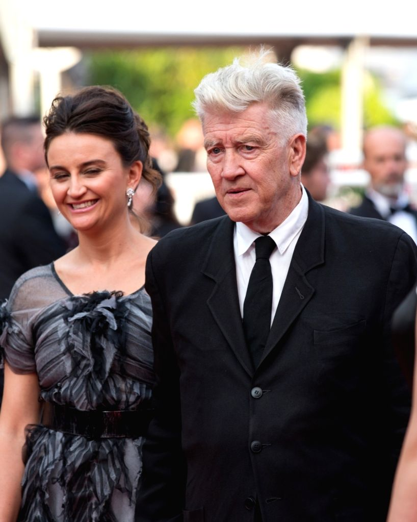 """CANNES, May 26, 2017 - US director David Lynch (R) and his wife Emily Stofle pose on the red carpet for the screening of the new episodes of """"Twin Peak"""" during the 70th annual Cannes Film ... - David Lynch"""