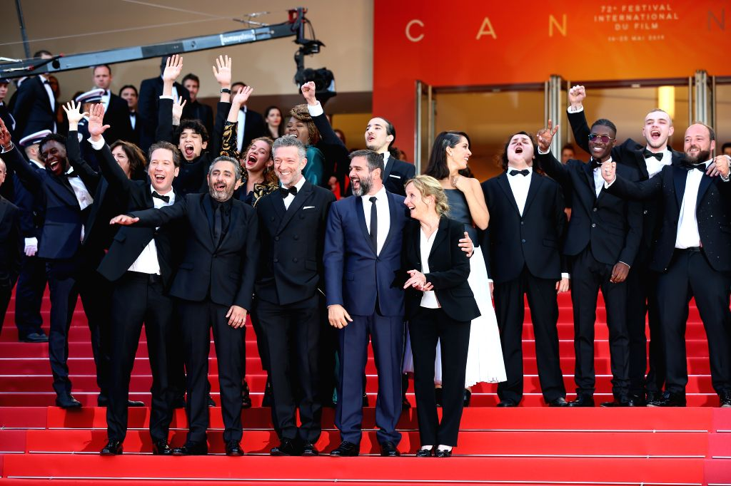 """CANNES, May 26, 2019 - Cast members of the film """"Hors Normes"""" pose on the red carpet of the closing ceremony of the 72nd Cannes Film Festival, in Cannes, France, on May 25, 2019. The ..."""