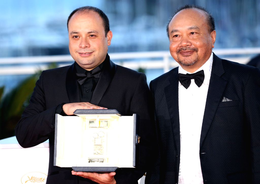 """CANNES, May 26, 2019 - Cesar Diaz (L), winner of the Camera d'Or award for the film """"Nuestras Madres"""" poses with President of the Camera d'or jury Rithy Panh during a photocall at the 72nd ..."""