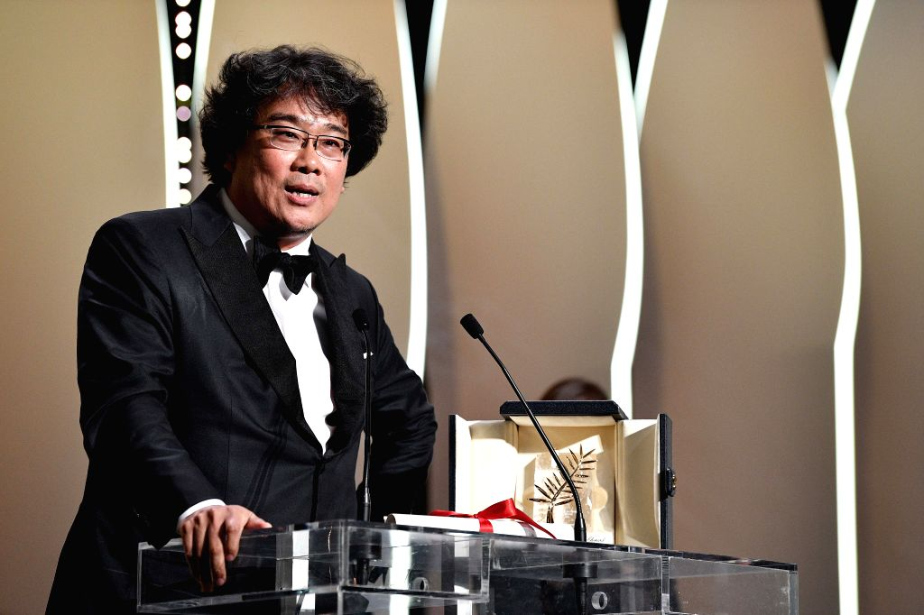 """CANNES, May 26, 2019 - Director Bong Joon-Ho receives the Palme d'Or award for """"Parasite"""" on stage during the closing ceremony of the 72nd Cannes Film Festival in Cannes, France, on May 25, ..."""