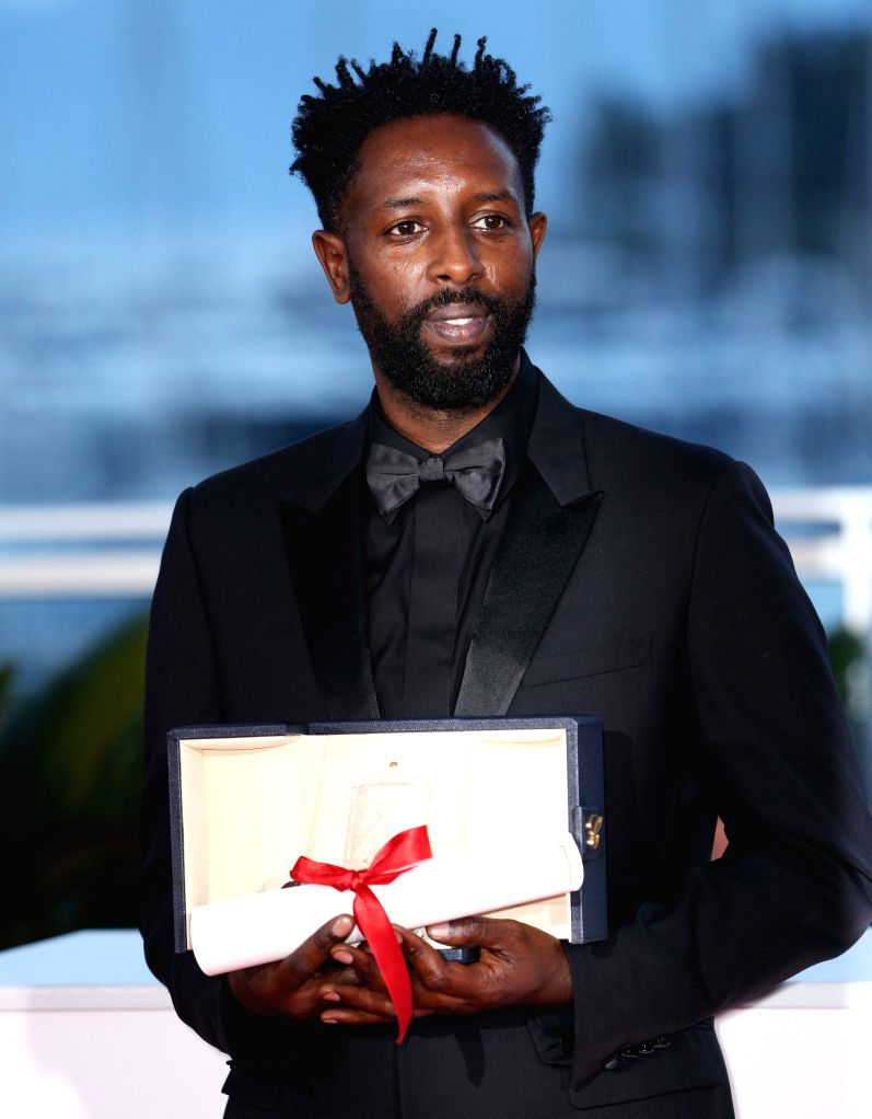"""CANNES, May 26, 2019 - Director Ladj Ly, with his jury prize for the film """"Les Miserables"""" poses during a photocall at the 72nd Cannes Film Festival in Cannes, France, on May 25, 2019. The ..."""