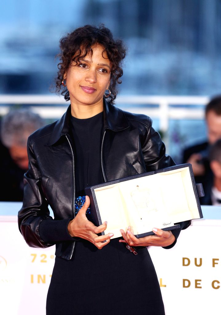"""CANNES, May 26, 2019 - Director Mati Diop, winner of the grand prix award for the film """"Atlantique"""" poses during a photocall at the 72nd Cannes Film Festival in Cannes, France, on May 25, ..."""