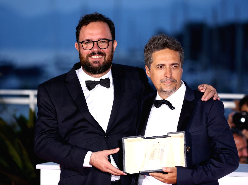 """CANNES, May 26, 2019 - Directors Juliano Dornelles (L) and Kleber Mendonca Filho, co-winners of the jury prize for the film """"Bacurau"""" pose during a photocall at the 72nd Cannes Film ..."""
