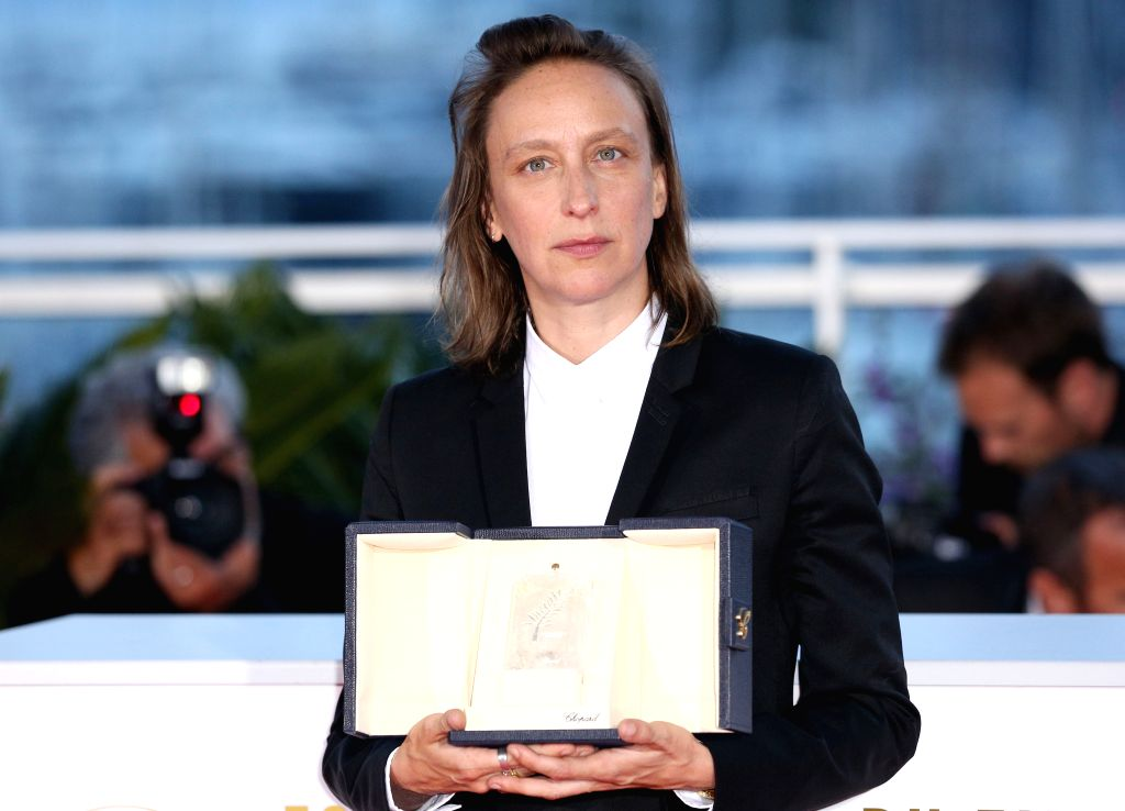 """CANNES, May 26, 2019 - French director Celine Sciamma, winner of the Best Screenplay prize for the film """"Portrait of a Lady on Fire"""" poses during a photocall at the 72nd Cannes Film ... - Celine Sciamma"""