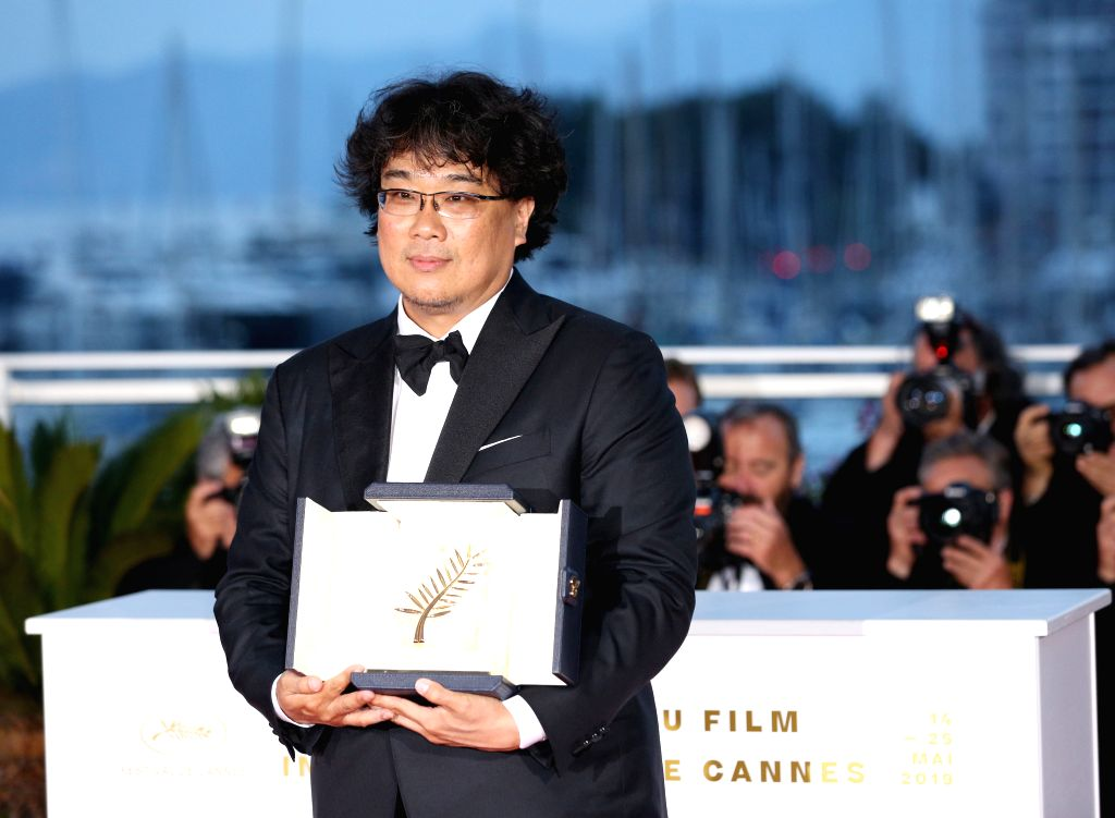 """CANNES, May 26, 2019 - South Korean director Bong Joon-Ho, winner of the Palme d'Or award for the film """"Parasite"""" poses during a photocall at the 72nd Cannes Film Festival in Cannes, ... - Bong Joon-H"""