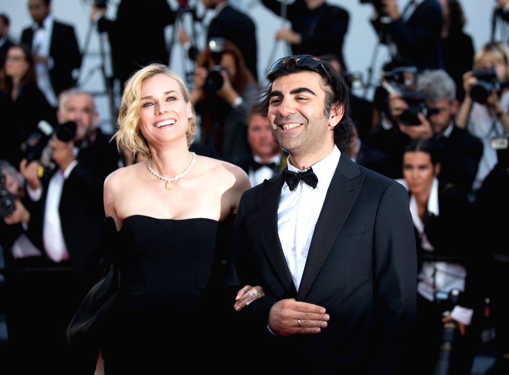 """CANNES, May 29, 2017 - Actress Diane Kruger, winner of the Best Actress Award for the film """"In The Fade"""", poses with director Fatih Akin on the red carpet of the closing ceremony of the ... - Diane Kruger"""