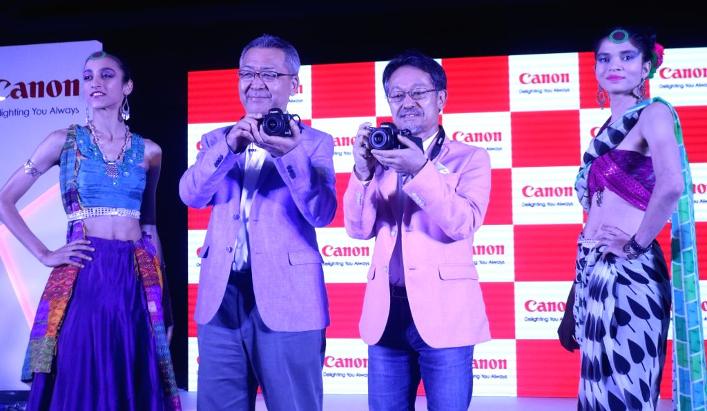 Canon India president and CEO Kazutada Kobayashi along with Eddie Udagawa,vice president, Consumer Engaging and Information Centre, Canon India at the launch of new mirrorless EOS M50 ...