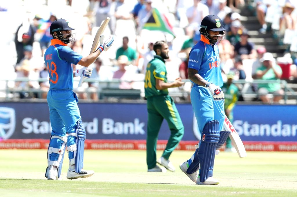 Cape Town: Indian skipper Virat Kohli applauds Shikhar Dhawan as he reaches his half century during the 3rd ODI match between India and South Africa at the Newlands Cricket Ground in Cape Town, South ... - Shikhar Dhawan and Virat Kohli