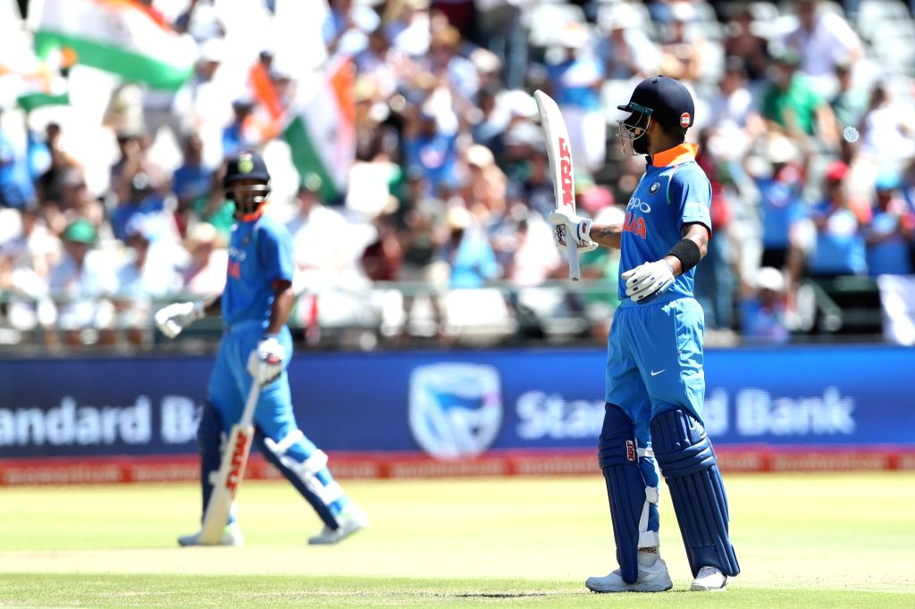 Cape Town: Indian skipper Virat Kohli raises his bat on reaching his half century during the 3rd ODI match between India and South Africa at the Newlands Cricket Ground in Cape Town, South Africa on ... - Virat Kohli
