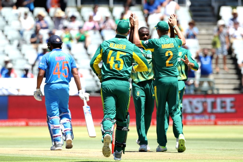Cape Town: Kagiso Rabada of South Africa celebrates fall of Rohit Sharma's wicket during the 3rd ODI match between India and South Africa at the Newlands Cricket Ground in Cape Town, South Africa on ... - Rohit Sharma