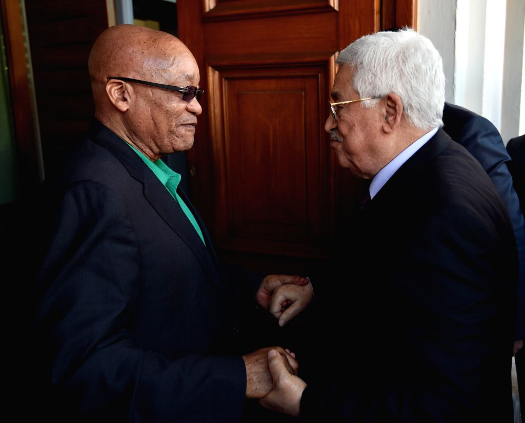 CAPE TOWN, May 25, 2016 - South African President Jacob Zuma (L) holds hands with his Palestinian counterpart Mahmoud Abbas in Cape Town, South?Africa, on May 25, 2016.?South?Africa?will continue to ...