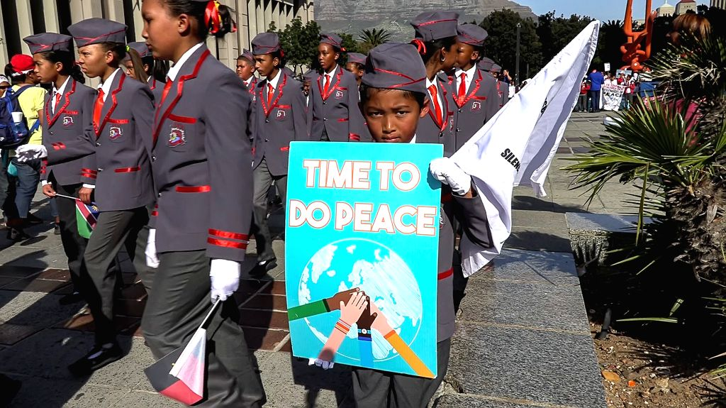 CAPE TOWN, May 25, 2019 - A girl holds a placard during the peace walk in Cape Town, South Africa, on May 25, 2019. Thousands of South Africans on Saturday took to the streets in Cape Town to mark ...