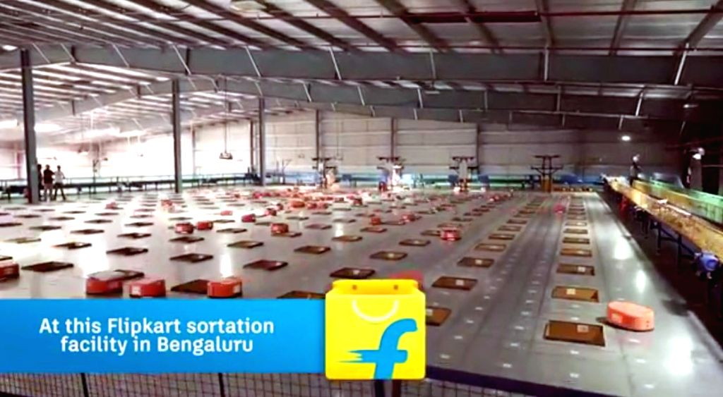 Caption: Bengaluru, June 11 (IANS) As India's leading e-tailer, Flipkart uses about 100 robots to sort out parcels automatically in thousands daily to minimize delays in delivering what customers buy online on its website, an official said on Tuesday