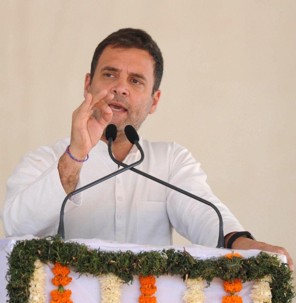 Caption: Congress President Rahul Gandhi addresses a public rally in Karnataka's Kolar, on April 13, 2019. - Rahul Gandhi