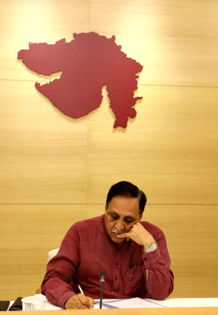 Caption: Gujarat Chief Minister Vijay Rupani. - Vijay Rupani
