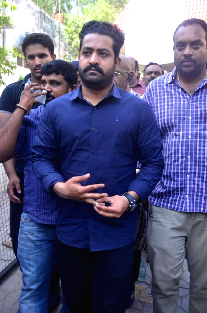 Caption: Hyderabad: NTR pays last respect to Dasari Narayana Rao at his residence. - Dasari Narayana Rao
