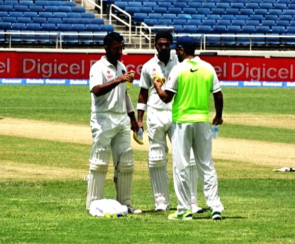 Caption : Kingston: Indian cricketers Cheteshwar Pujara and Lokesh Rahul during the second test match between India and West Indies at Kingston, Jamaica July 31, 2016. - Lokesh Rahul