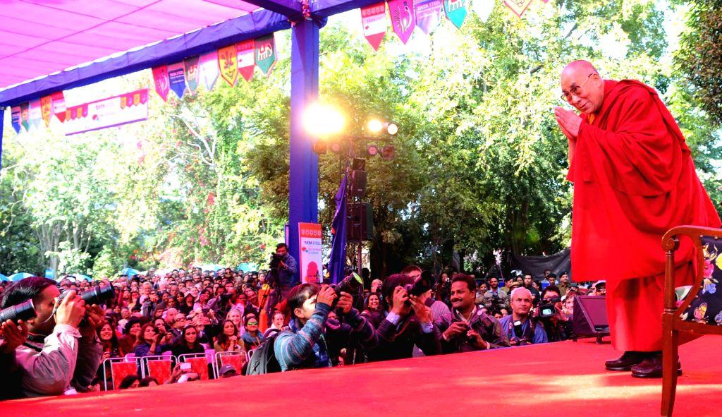 The Dalai Lama greeting visitors at the Jaipur Literature Festival Thursday.