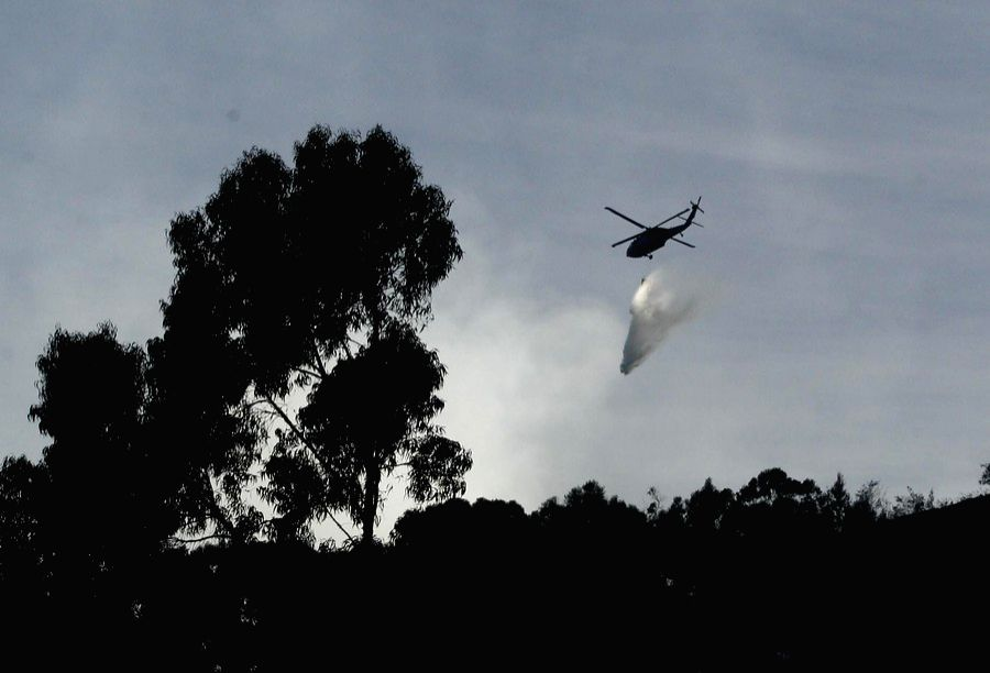 A helicopter operates recue works after an aircraft accident in Caqueta department, Colombia, on Sept. 6, 2014. Colombia's Civil Aviation confirmed on Staurday that