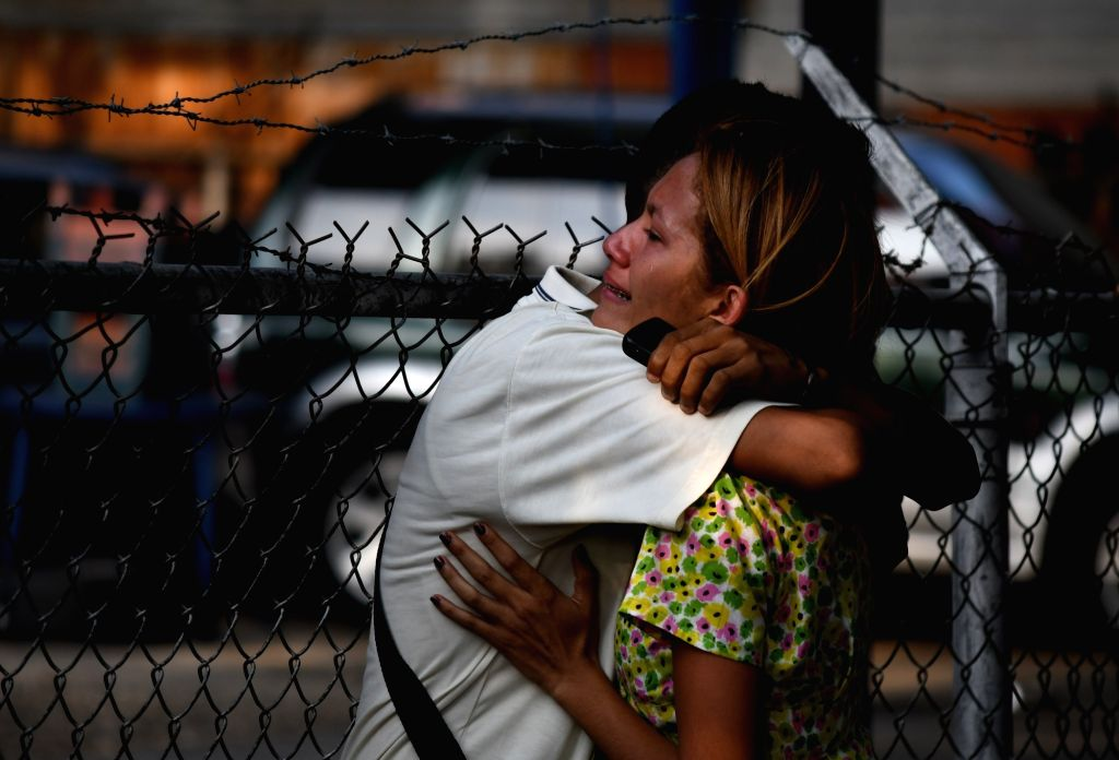CARABOBO, March 29, 2018 - Relatives react after an alleged fire at a Venezuelan police station, in Valencia, Carabobo state, Venezuela, on March 28, 2018. A prison riot and fire has broken out at a ...