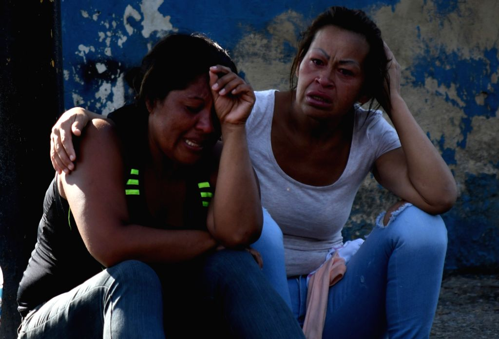 CARABOBO, March 29, 2018 - Relatives react as they wait for information after an alleged fire at a Venezuelan police station, in Valencia, Carabobo state, Venezuela, on March 28, 2018. A prison riot ...