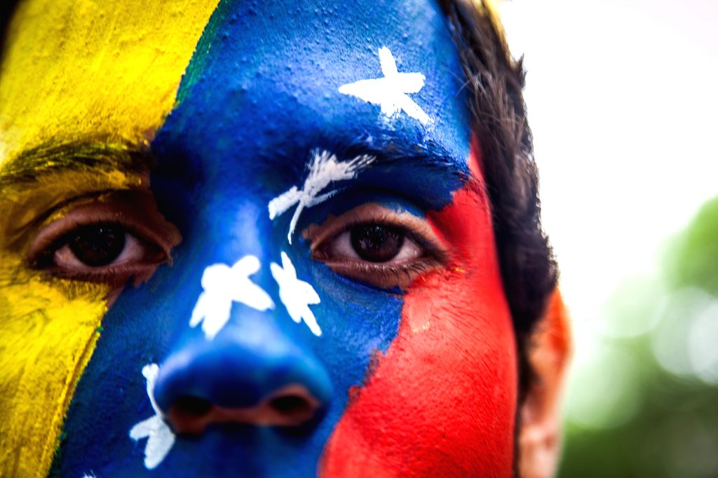 A young man with a Venezuela's national flag painted on his face participates in an anti-government protest in the Altamira neighborhood of Caracas, Venezuela, on .
