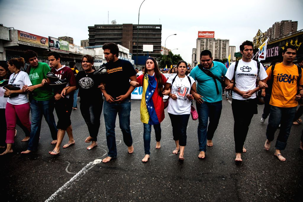 """Students and members of civil society take part in the """"Barefoot March"""" in Caracas, Venezuela, on April 16, 2014. The """"Barefoot March"""" was ..."""