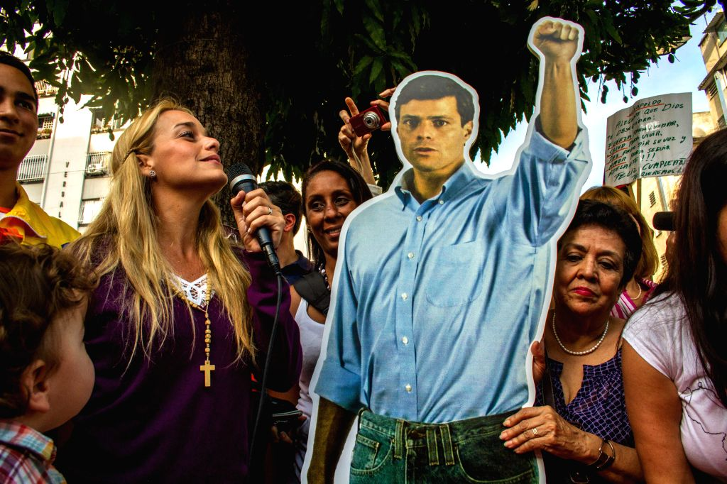 Lilian Tintori (2nd L), wife of Venezuela's opposition leader Leopoldo Lopez, delivers a speech as she celebrates with her children on Leopoldo Lopez's 43rd ...