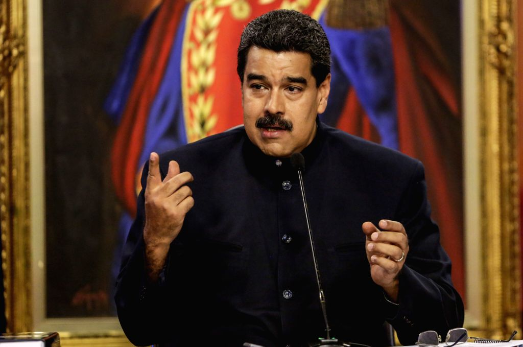 CARACAS, Aug. 23, 2017 (Xinhua) -- Venezuelan President Nicolas Maduro speaks during a press conference in Caracas, capital of Venezuela, on Aug. 22, 2017. Maduro announced on Tuesday that his government was taking steps to defend the country against