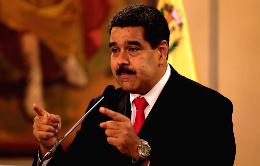 CARACAS, Aug. 5, 2018 (Xinhua) -- Venezuela's President Nicolas Maduro speaks during a nationally televised address from the Miraflores Palace in Caracas, capital of Venezuela, Aug. 4, 2018. Nicolas Maduro escaped unharmed from an attempted attack of