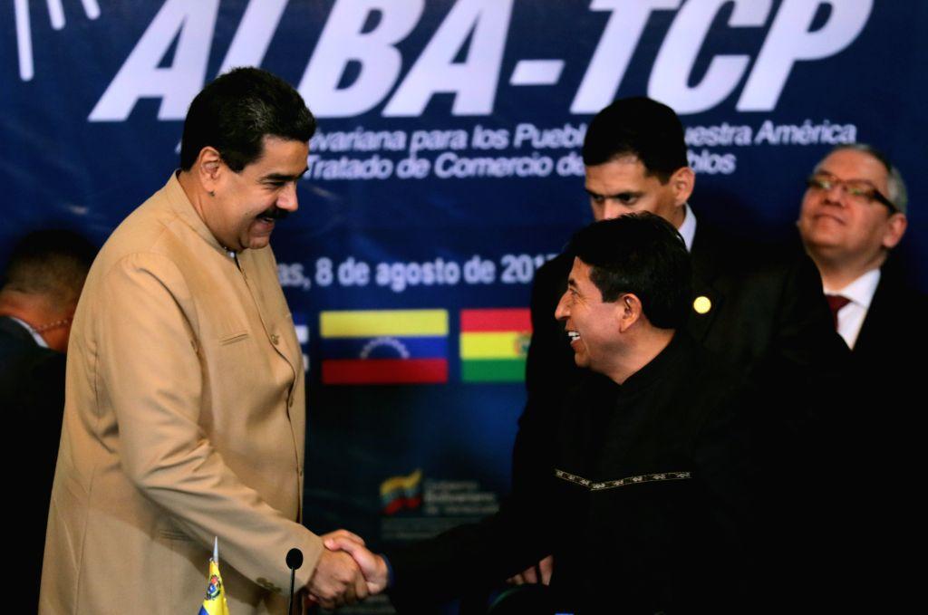 CARACAS, Aug. 9, 2017 - Image provided by Venezuela's Presidency shows Venezuelan President Nicolas Maduro (L) shaking hands with former Bolivian Foreign Minister David Choquehuanca during the ... - David Choquehuanca