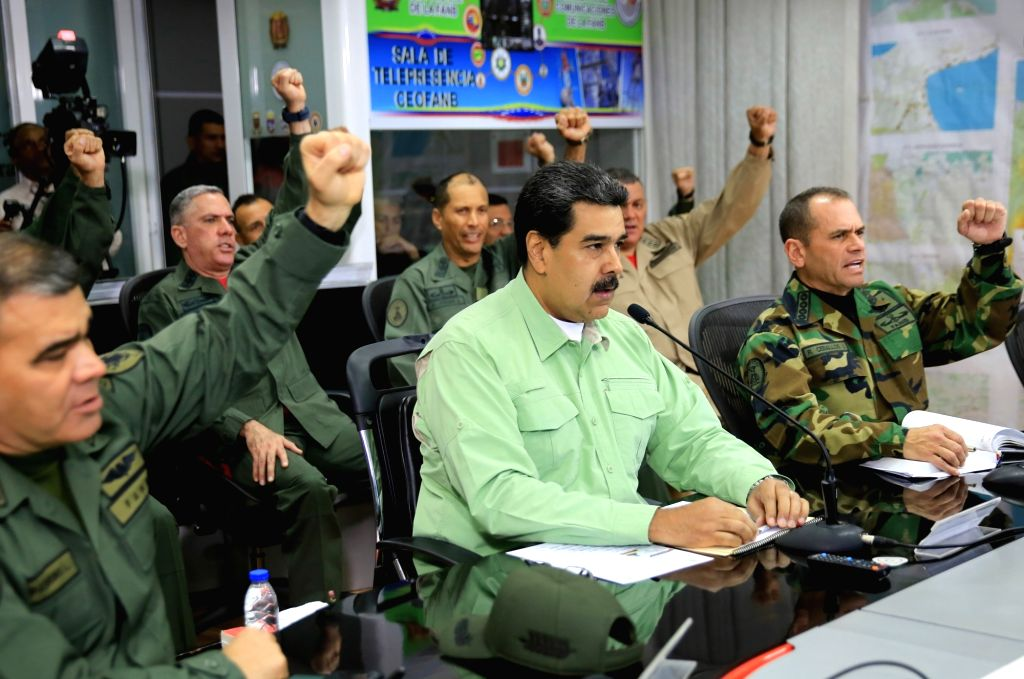 CARACAS, Feb. 22, 2019 (Xinhua) -- Image provided by Venezuela's Presidency shows Venezuelan President, Nicolas Maduro (C, front), taking part in a meeting with the high command of the National Bolivarian Armed Forces, in Caracas, capital of Venezuel