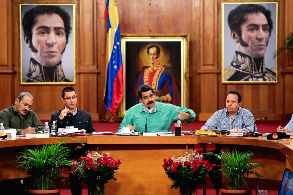 Image provided by Venezuela's Presidency shows Venezuelan President Nicolas Maduro (2nd R) addressing a meeting with Bolivarian governors and ministers of different .