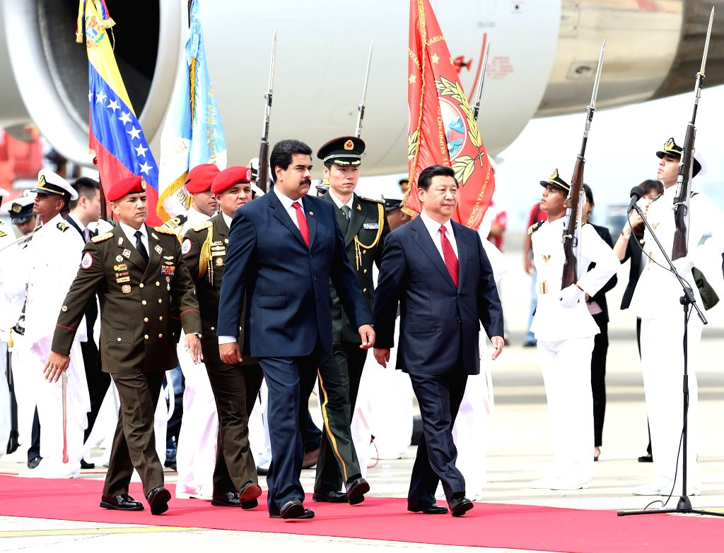 Chinese President Xi Jinping (R front) is welcomed by his Venezuelan counterpart Nicolas Maduro (L front) in Caracas, Venezuela, July 20, 2014. Xi arrived here on ..