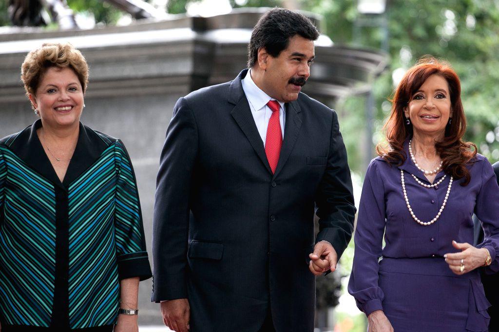 Venezuela's President Nicolas Maduro (C), Brazil's President Dilma Rousseff (L) and Argentina's President Cristina Fernandez take part in the XLVI Presidential ...