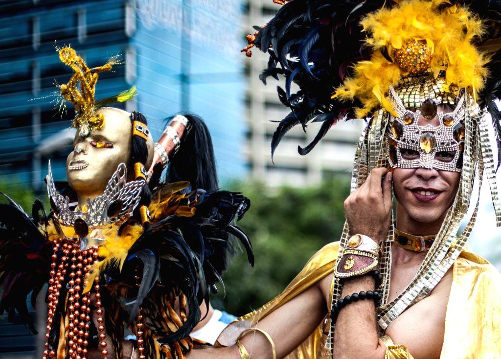 People participate in the Gay Pride Parade, in Caracas, Venezuela, on June 29, 2014.