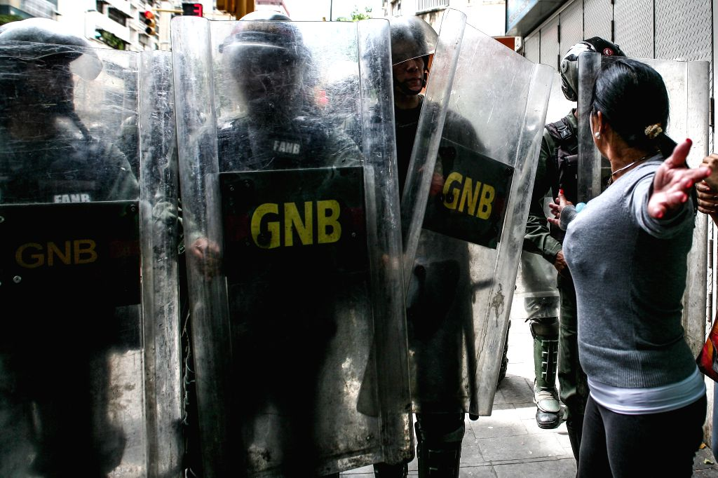 CARACAS, June 3, 2016 - Members of the National Bolivarian Guard stand guard during a protest against the shortage of food and medicines, near the Miraflores Palace, in Caracas, Venezuela, on June 2, ...