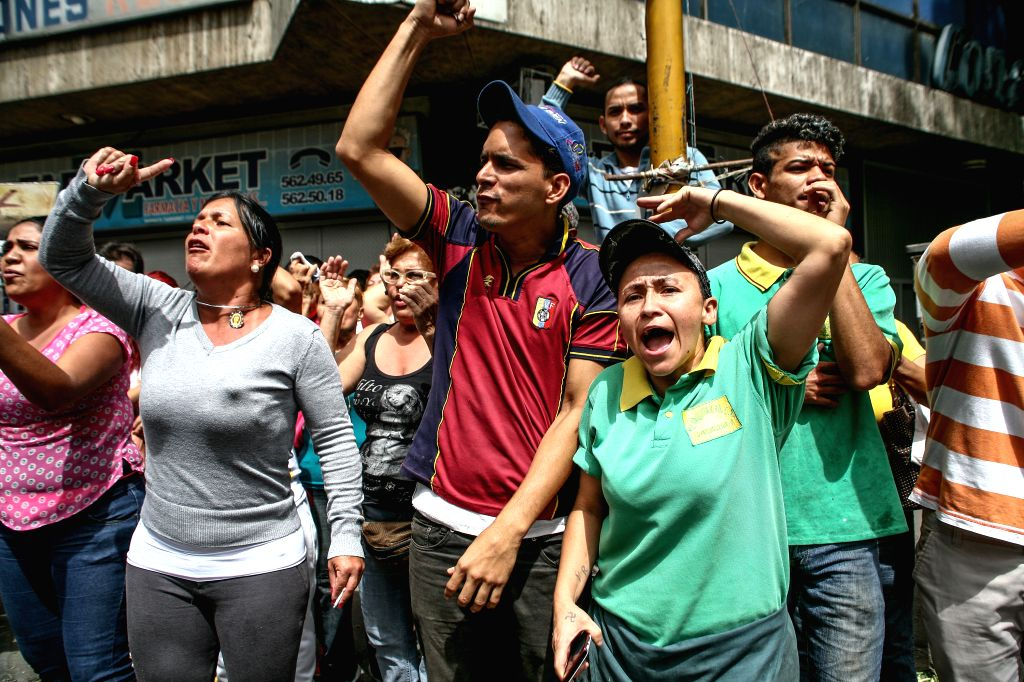 CARACAS, June 3, 2016 - People take part in a protest against the shortage of food and medicines near the Miraflores Palace, in Caracas, Venezuela, on June 2, 2016.