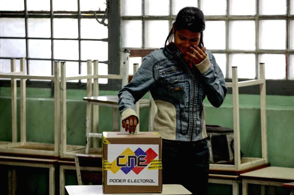 CARACAS, May 20, 2018 - A woman casts her vote at a voting station during the presidential elections in Caracas, Venezuela, on May 20, 2018